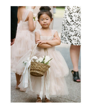 Serious flower girl with arms crossed