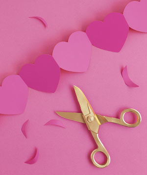 Paper construction of heart cutouts with scissors by Matthew Sporzynski