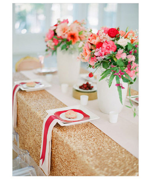 Metallic sheen tablecloth and pink centerpieces
