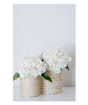 White hydrangea in a rope-wrapped vase