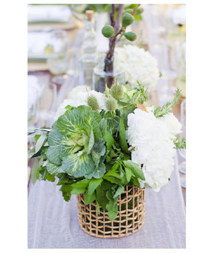 Hand-woven containers holding green and white centerpieces