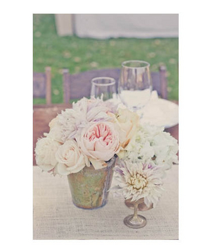 Pink rose, peony, and gardenia centerpieces in silver vases