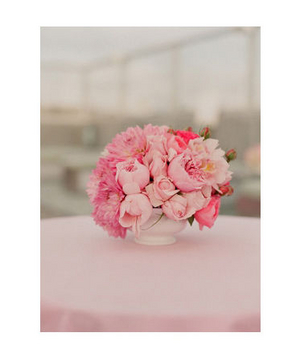 Low pink centerpiece on pink tablecloth
