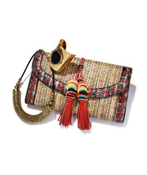Colorful raffia bag, hammered cuff, and beaded necklace