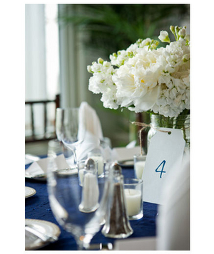 Navy tablecloths and white centerpieces