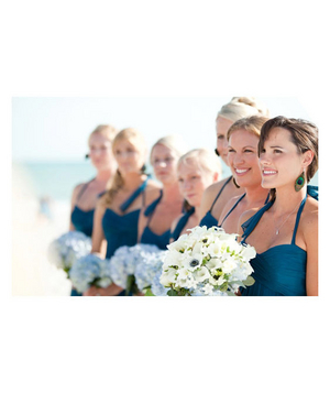 Bridesmaids wearing navy blue dresses
