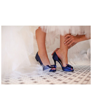 Bride wearing blue satin shoes