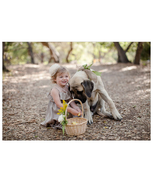 Flower girl sitting with dog