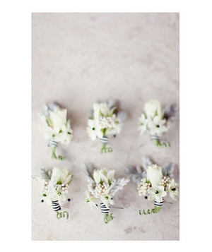 Black and white boutonnieres
