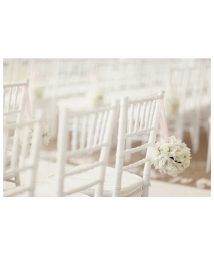 White chairs at a wedding ceremony