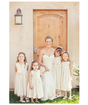Bride with flower girls dressed in white