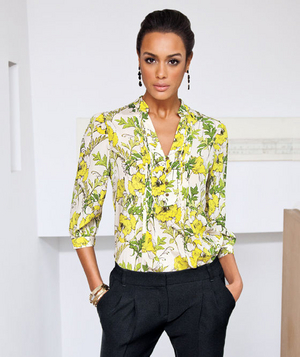 Model wearing yellow and green floral silk blouse