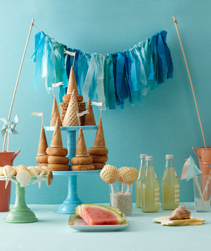 Fun ideas for beach theme bridal shower real simple beach themed bridal shower table arrangment junglespirit Image collections