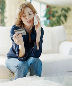 Woman paying by credit card on phone