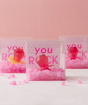 pink themed bridal shower rock candy and ring pop favors