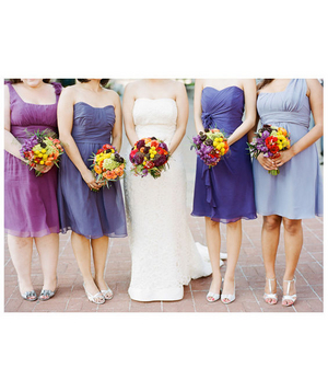 Bride and bridesmaids with purple dresses and colorful flowers
