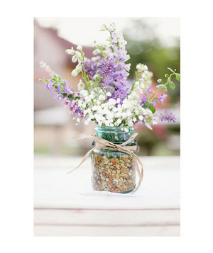 Purple and white bouquet in a glass jar