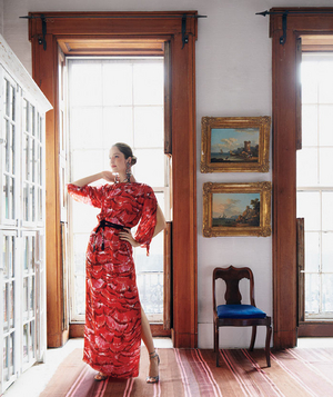 Model wearing red, printed silk maxi dress