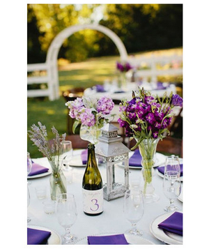Purple bouquets and antique lantern centerpieces
