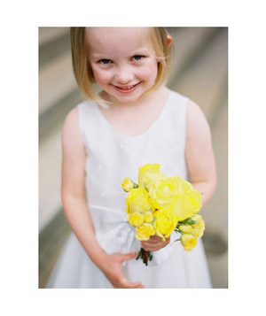 Flower girl with a yellow rose bouquet
