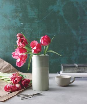 Pink tulips on a table and in a vase