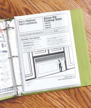 Binder holding instruction manuals