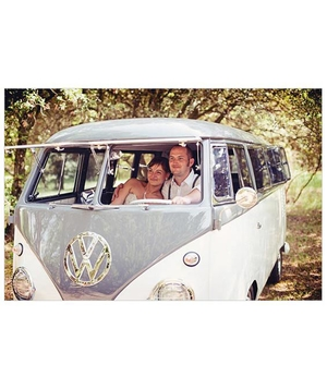 Newlyweds in a blue Volkswagon van
