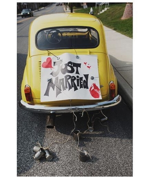 Just married sign on a yellow VW bug