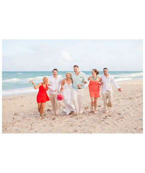 Bridal party walking on beach
