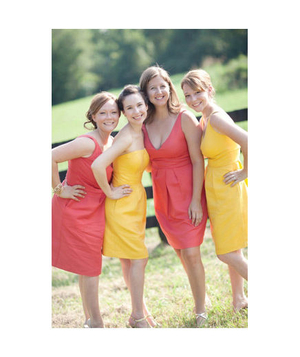 Bridesmaids in pink and yellow dresses
