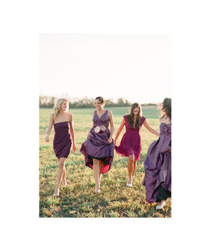 Bridesmaids walking in a field