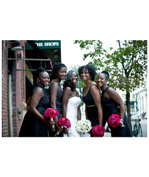 Bride and bridesmaids holding pink bouquets