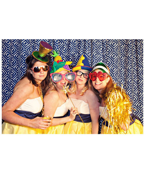 Bridesmaids in a photo booth with funny props