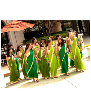 A group of bridesmaids in green saris