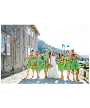 Bridesmaids wearing green dresses at a ranch wedding