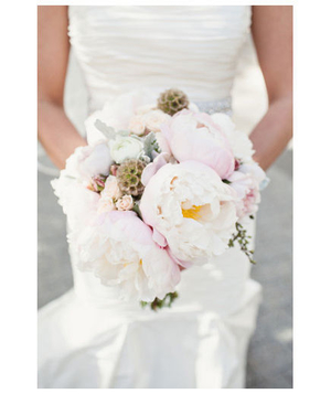 Bride holding white and pink peony bouquet