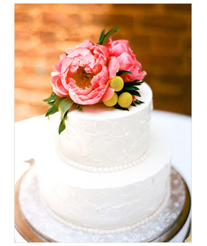 White wedding cake with pink peony topper