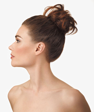 Model with a messy high bun
