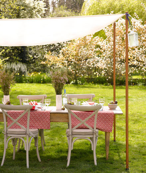 Fabric Canopy Covering A Dining Table On The Lawn