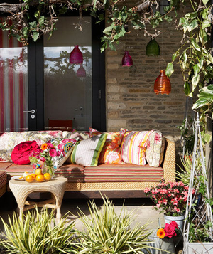 Rattan sofa and colorful glass lanterns