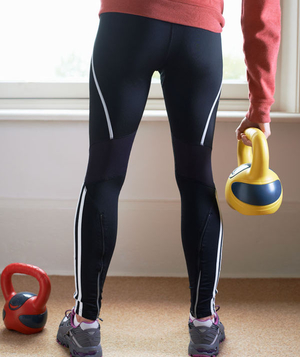 A woman training with kettlebells