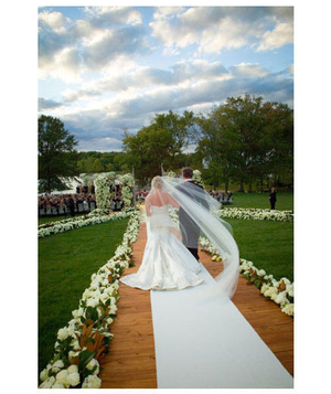 Bride walking down aisle outdoors