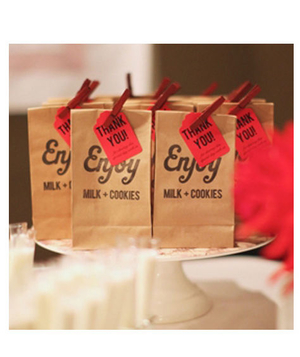 Milk and cookies in a bag as party favors
