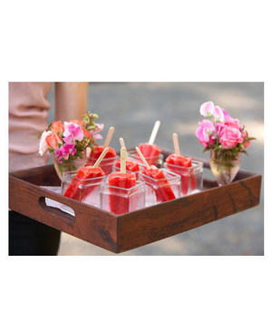 Pink popsicles on a tray
