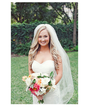 Bride with long blonde hair and a veil