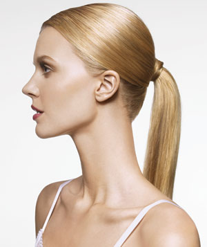 Model with long blonde hair in a pony tail