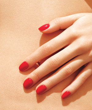 Model with red manicured nails