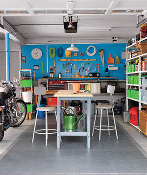 Organized garage with table and chairs