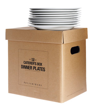Stack of Pottery Barn plates on a cardboard box