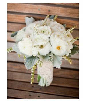 Bouquet of white ranunculus and light mint leaves